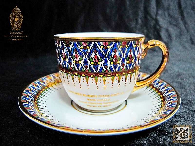 Coffee cup and saucer benjarong with Nha-Singha(lion's face) pattern design on a white color background