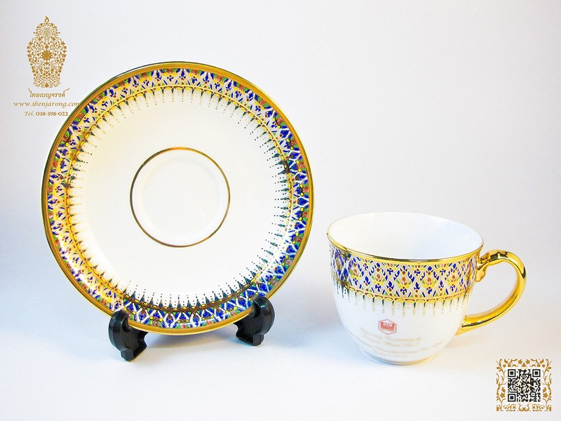 Coffee cup and saucer benjarong with Nha-Singha pattern design on white color background
