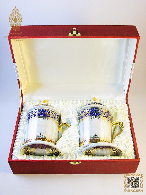 Pearl white on mug's shape with Phum-Kao-Bhin with gold bold the drawing line pattern design on blue color background