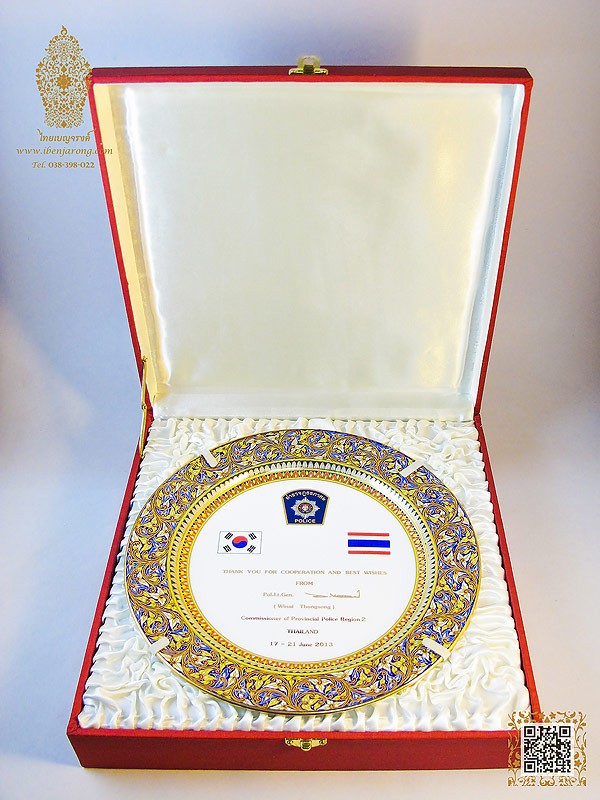 Show plate Benjarong with Immortal-rolling pattern design on blue color background come together with silk box